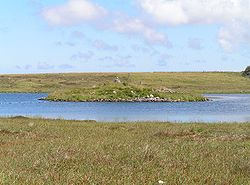 Ruined dun in Loch Steinacleit on the Isle of Lewis