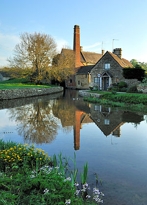 English: The mill and Cotswold cottage at Lowe...