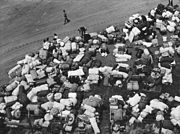 Baggage of Japanese Americans evacuated from certain West coast areas under United States Army war emergency order, who have arrived at a reception center at a racetrack.