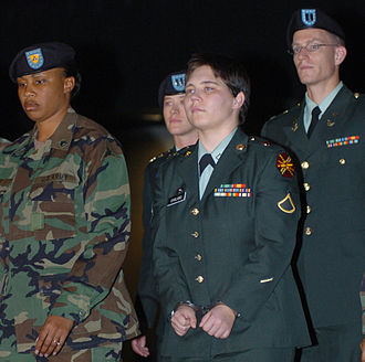 Lynndie England - England being escorted out of Williams Judicial Center at Fort Hood after being sentenced to three years in prison