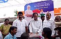 M. Venkaiah Naidu distributing the clothes marking the occasion of the Prime Minister, Shri Narendra Modi's birthday in Leprosy colony, at Kesarpally, in Gannavarm mandal, Krishna District of Andhra Pradesh.jpg