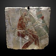 Man with papyrus bundle-MAHG 4583