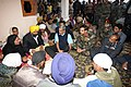 Manohar Parrikar along with the Chief of the Air Staff, Air Chief Marshal Arup Raha and the Chief of Army Staff, General Dalbir Singh offering condolences to the family members of Late Lance Naik Kulwant Singh.jpg