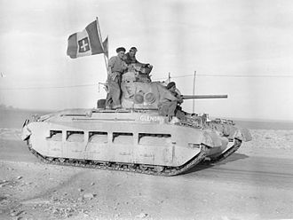 "North African Campaign - A British Matilda Mk II named ""Glenorchy"" of Maj K.P. Harris, MC, commander of 'D' Squadron, 7th Royal Tank Regiment during Operation Compass displaying an Italian flag captured at Tobruk, 24 January 1941"