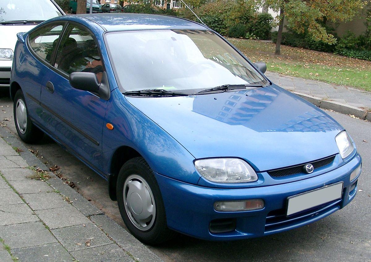 1200px-Mazda_323_front_20071025.jpg