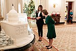 Melania Trump shows Laura Bush the gingerbread house during a Christmas tour.jpg