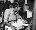 Migrant Cotton Picker and Her Baby near Buckeye, Maricopa County, Arizona (3678688183).jpg