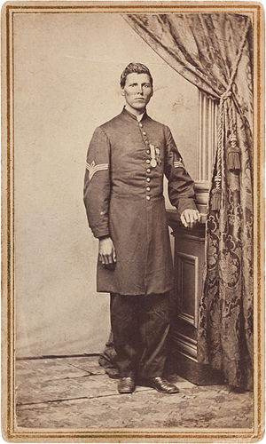 Milton M. Holland - This photo of Holland appears to have been taken later than the other wartime one.  The large medal he's wearing could by the Medal of Honor, which would place this photo in 1865, when he was awarded the medal.