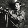 Miner with helmet and hydraulic drill in Sulitjelma.jpg