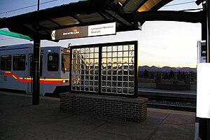 Littleton–Mineral station - D Line train entering station after turning back south of the station
