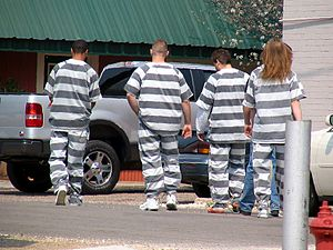Prison uniform - Inmates outfitted in common present-day prison uniforms (faded black-white), US