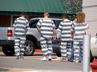 "Unfree labour - American prisoner ""chain gang"" laborers, 2006. Notice the shackles on the feet of the prisoners."