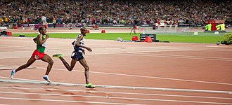 Athletics at the 2012 Summer Olympics – Men's 10,000 metres - Farah leading Bekele in the final turn