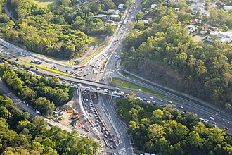 Western Freeway, Brisbane - Aerial view of Moggill Road and Western Freeway Interchange Upgrade. The regular traffic congestion on the Western Freeway is visible.