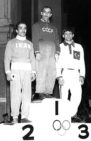 Hüseyin Akbaş - Akbaş (right) at the 1956 Olympics