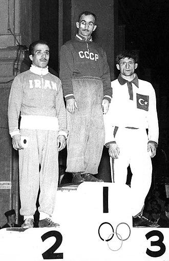 Mirian Tsalkalamanidze - Tsalkalamanidze (center) at the 1956 Olympics