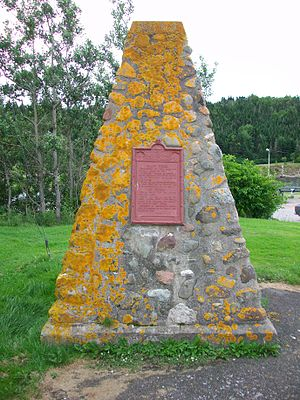 St. Peter's, Nova Scotia - Monument on the site of Denys' post at Saint-Pierre. The south entrance to the Canal is in the background.
