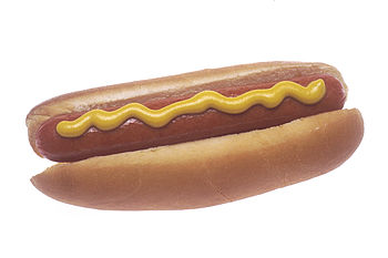 A cooked hot dog garnished with mustard.