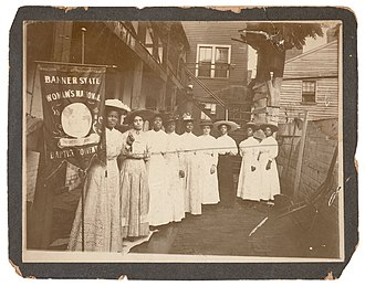 Nannie Helen Burroughs - Burroughs holding Woman's National Baptist Convention banner.