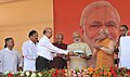 Narendra Modi being presented a memento at the inauguration ceremony of the Badarpur-Faridabad Metro Line, at Faridabad. The Governor of Punjab and Haryana and Administrator, Union Territory, Chandigarh.jpg