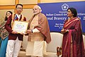 Narendra Modi presenting the National Bravery Awards 2015 to the children, in New Delhi on January 24, 2016. The Union Minister for Women and Child Development, Smt. Maneka Sanjay Gandhi is also seen (16).jpg