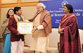 Narendra Modi presenting the National Bravery Awards 2015 to the children, in New Delhi on January 24, 2016. The Union Minister for Women and Child Development, Smt. Maneka Sanjay Gandhi is also seen (2).jpg