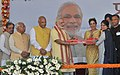 Narendra Modi presents the house keys to beneficiaries at the inauguration of the New Housing Scheme, in Chandigarh. The Governor of Punjab and Haryana and Administrator, Union Territory, Chandigarh (3).jpg