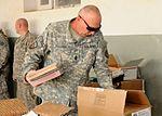 National Guardsmen distribute school supplies DVIDS342543.jpg