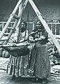 Nestorians butter-making in a goatskin churn, late 19th century.jpg