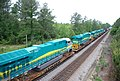 New GE locomotives transported on flat cars for export • 09.jpg