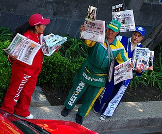 Uniform - Uniformed newspaper vendors in Mexico City. Some work places require their employees to wear a uniform.