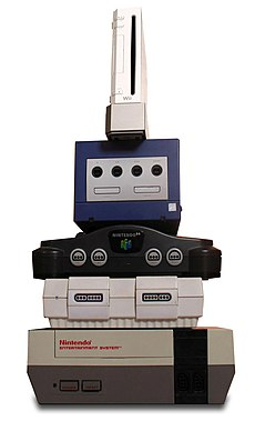 Stack of video-game consoles, of which the Wii is the smallest