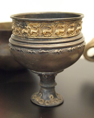 Tangendorf disc brooch - Partly reconstructed Nordrup Silver Goblet showing similar rear-facing animals at National Museum of Denmark