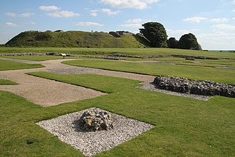Old Sarum - The present ruins: the exposed foundations of the cathedral in the foreground and the Norman central motte behind.