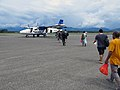 Passengers board a flight to Santa Ana, Makira to attend Wogasia, the spear festival. (10712551715).jpg