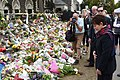 Patsy Reddy gave a moment of silence in front of the tributes.jpg