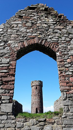 Peel Castle - The 10th or 11th century Round Tower viewed through the window of St. Patrick's Church