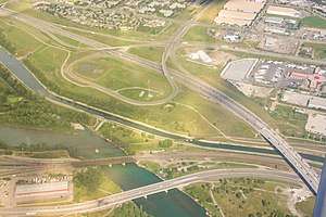 Deerfoot Trail - The ramp from westbound Peigan Trail to southbound Deerfoot Trail was modified in 2009 to loop back upon itself, allowing for a greater merge distance before crossing Ogden Road and the Bow River
