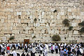 People praying at the Western Wall (12395524535).jpg