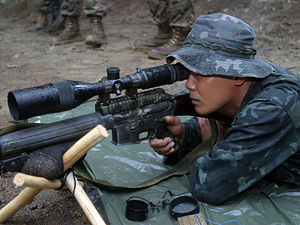 Marine Scout Sniper Rifle - A Marine from the Philippine Marine Corps fires the MSSR during marksmanship training in the Cooperation Afloat Readiness and Training 2007 exercises.