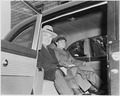 Photograph of President Truman sitting in the back of his limousine with his White House physician, General Wallace... - NARA - 200175.tif