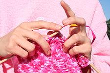 Pink knitting in front of pink sweatshirt.JPG