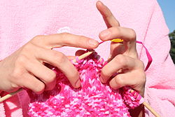 A little dexterity is helpful in working with knitting needles