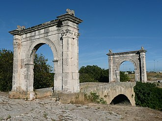 Pont Flavien - The single-arched bridge framed by two triumphal arches