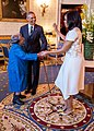 President Barack Obama watches First Lady Michelle Obama dance with 106-Year-Old Virginia McLaurin in the Blue Room.jpg