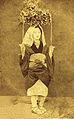 Pretty girl as oharame (大原女 or おはらめ).photograph.circa 1870s.jpg