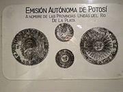 """. es descripto del siguiente modo: """"en oro, un sol naciente, . primeras monedas argentinas"""