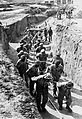 """Prisoners hauling earth for the construction of the """"Russian camp"""" at Mauthausen.jpg"""