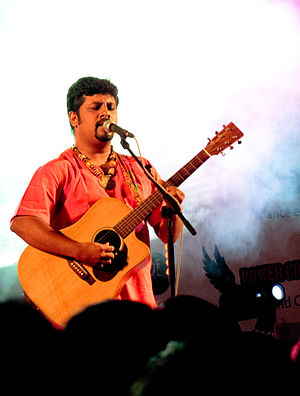 Raghu Dixit - Dixit performing at a concert, 2010