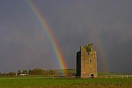 Rainbow and castle near Cashel.jpg
